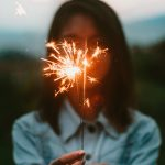 woman holding sparkler fire cracker